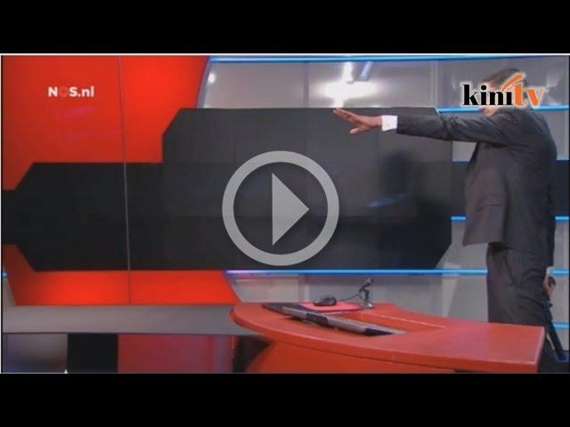 Armed man interrupts Dutch TV before being overpowered